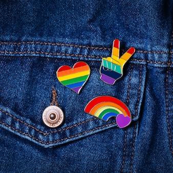 Rainbow lgbtq flag badges against denim background pride month