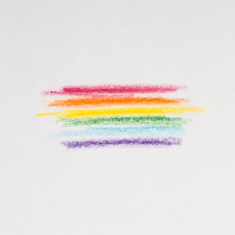Rainbow lines drawing with pencils on gray background