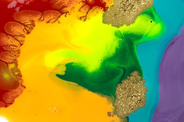 Rainbow liquid acrylic mixed ink texture with gold dust.