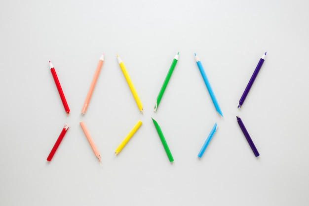 Rainbow made of six colorful pencils
