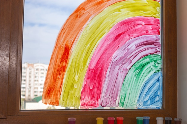 Rainbow painted with paints on window. close-up.