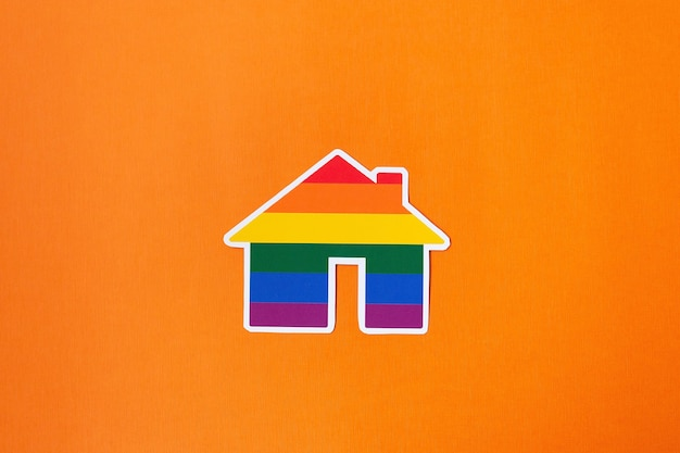 The rainbow paper house lgbt on an orange background