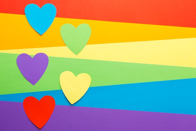 Rainbow pride flag with cutout paper hearts