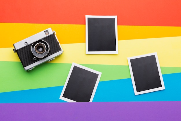 Rainbow pride flag with film camera and photos