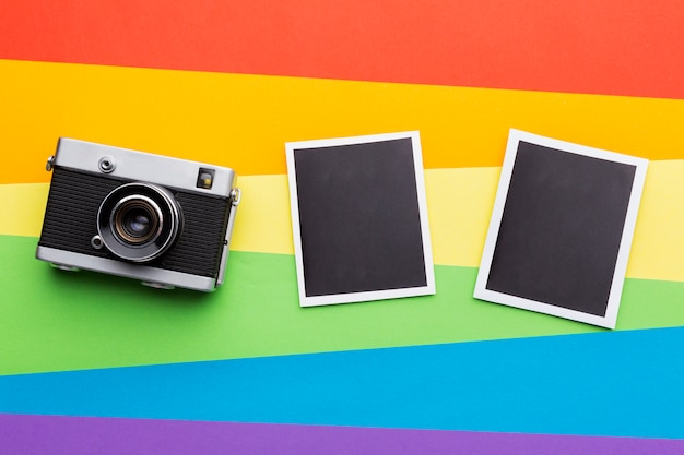 Rainbow pride flag with vintage camera and photos