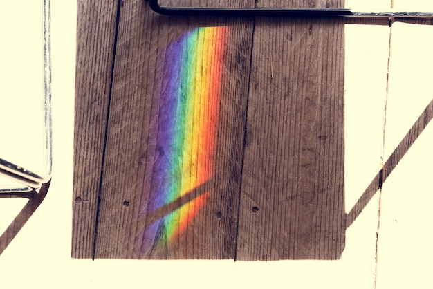 Rainbow reflect on the shadow of the chair