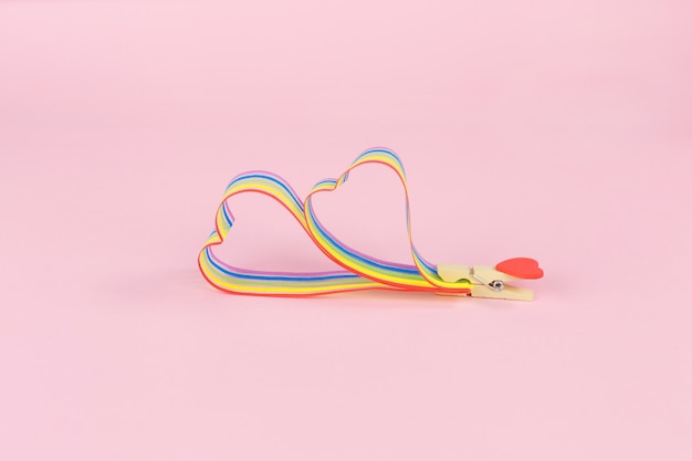 Rainbow ribbon awareness for lgbt community on pink