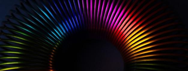Rainbow slinky over dark background, panoramic image
