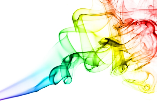 Rainbow smoke on white background. smoke goes from bottom to top. smoke spirals closer to top of the photo