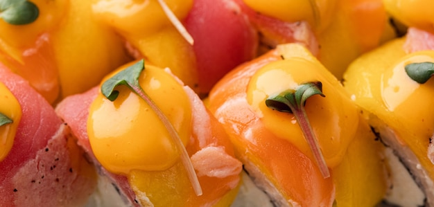 Rainbow sushi roll with salmon tuna avocado royal prawn cream cheese philadelphia caviar tobica chuka sushi menu japanese food high quality photo