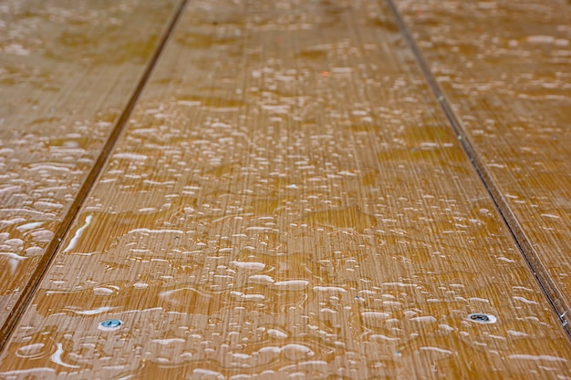 Raindrops on the plywood boards brown