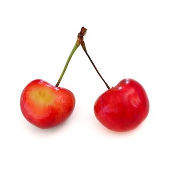 Сладкий и здоровый rainier вишни на белом фоне, свежие фрукты
