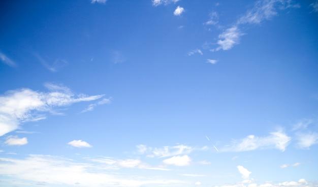 Rainy clouds across blue sky background