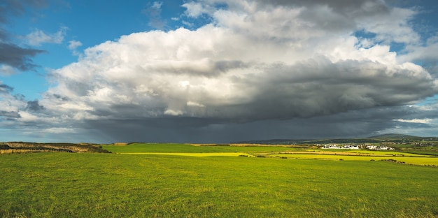 Rainy sky above the green field northern ireland panoramic view breathtaking landscape the huge