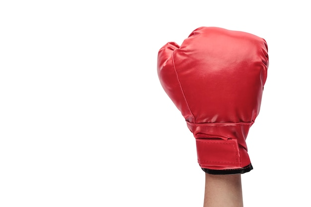 Raised arm with closed fist with red boxing glove on white background