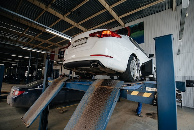Raised car on the lift in the service station to diagnose the exhaust system. service station