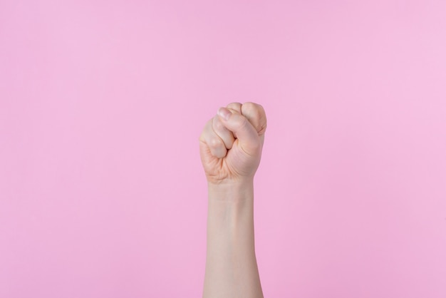Raised clenched fist isolated