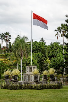 Raised flag of indonesia in outdoor park.