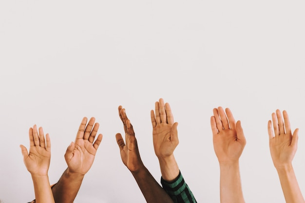 Raised people hands of different nationalities