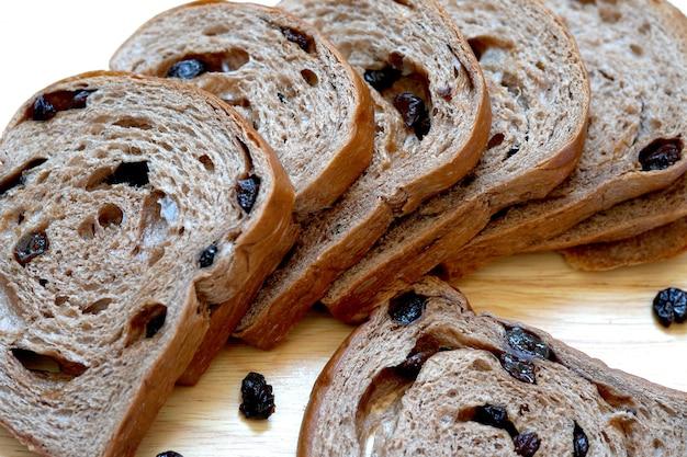 Raisin bread sliced on wooden board