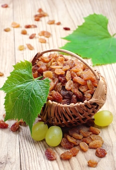 Raisin in a wicker basket and grapes