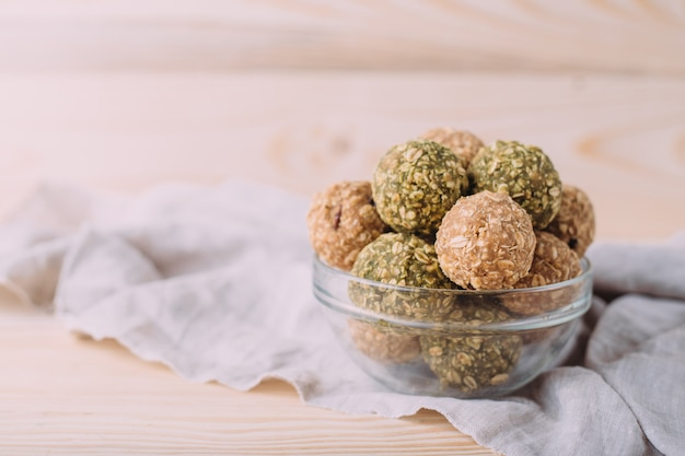 Raisins almond honey bliss balls. healthy oatmeal snacks energy balls with oats almond butter and honey.