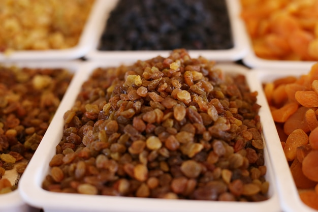 Raisins, dried fruits, on the market counter.