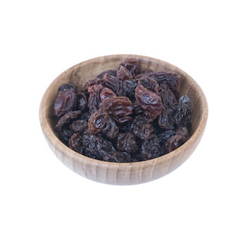Raisins (sultanas) in bowl wood isolated on white