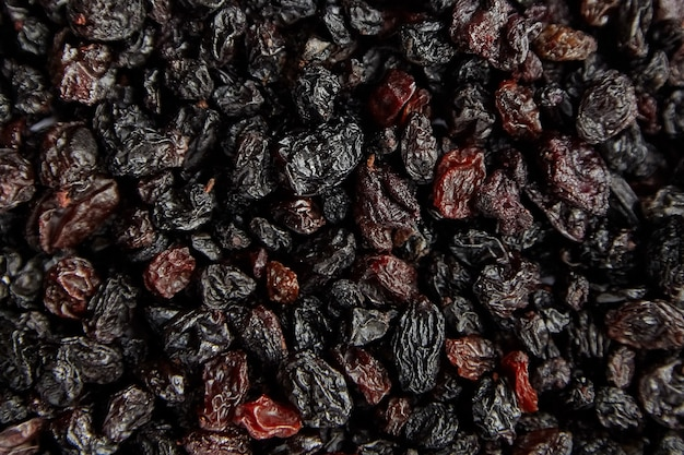Raisins texture background dried red grapes top view