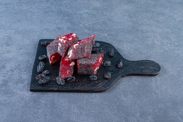 Raisins and turkish delights in a cutting, on the marble surface