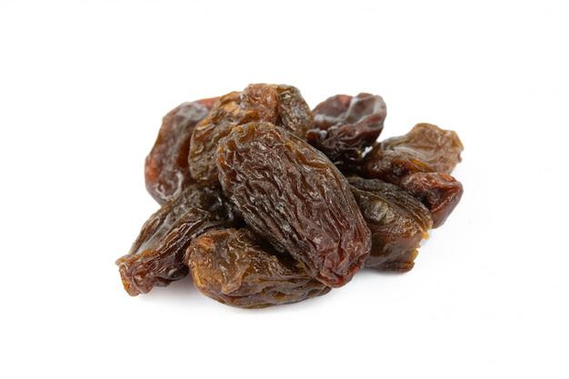 Raisins on white wall