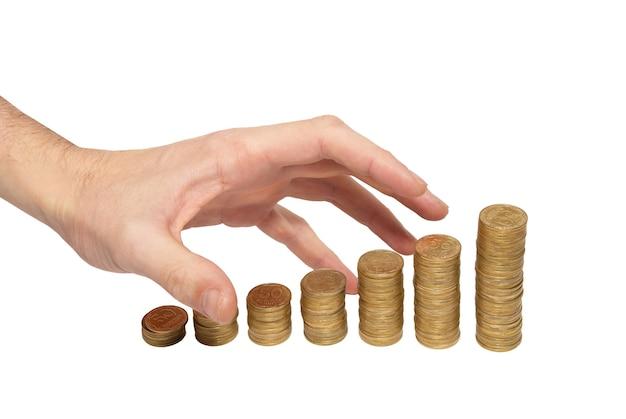 白で隔離されたお金の手をかき集めます。