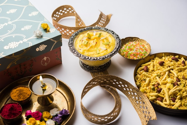 Raksha bandhan festival : conceptual rakhi made using shrikhand in a bowl with band and pooja thali. a traditional indian wrist band which is a symbol of love between brothers and sisters