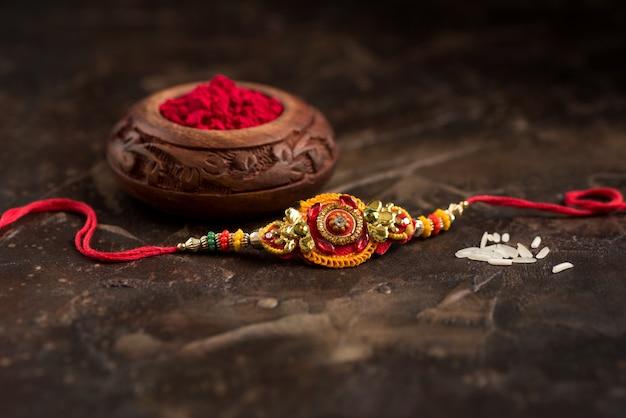 Raksha bandhan and kumkum in a bowl