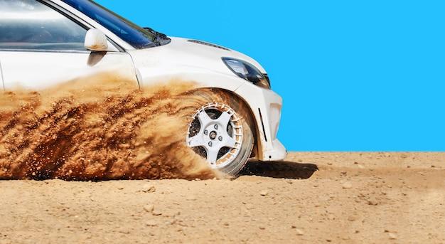 Rally racing car on dirt track