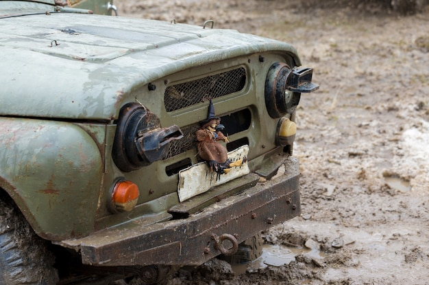 Rally on russian suvs in the mud in winter trapped allterrain vehicle pulled out of the river