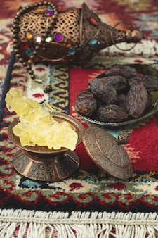 Ramadan composition with candies and dried dates