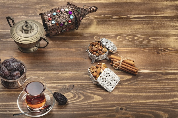 Ramadan composition with cup of tea and dried dates