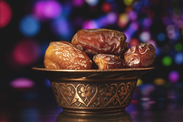 Ramadan composition with dried of dates on black surface