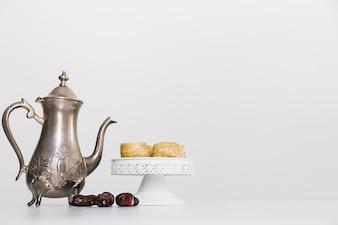 Ramadan composition with tea pot and arab food