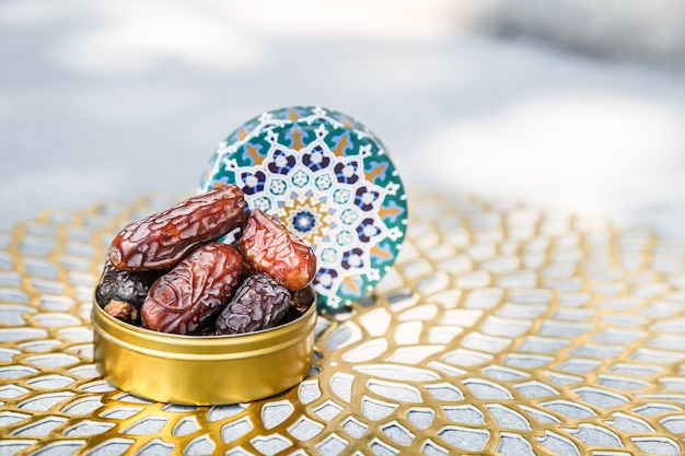 Ramadan concept and some dates in an islamic pattern container