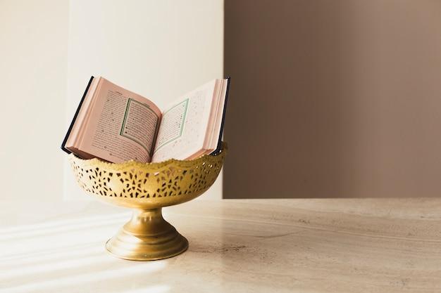 Ramadan concept with quran in bowl