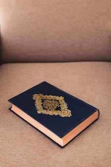 Ramadan concept with quran on couch