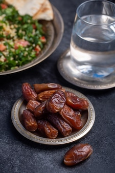 Ramadan dates, water and tabbouleh is traditional food for iftar in islamic world