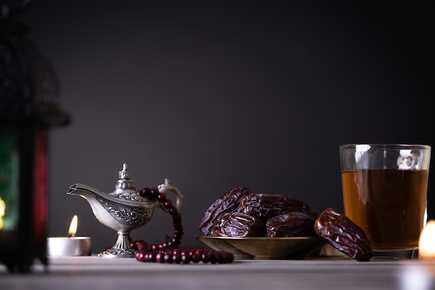 Ramadan food and drinks concept. ramadan lantern with arabian lamp
