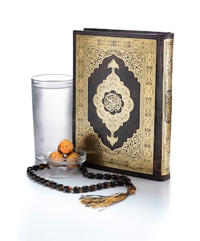 Ramadan items, quran holy book, water, dates and rosary