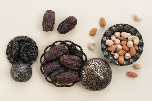 Ramadan kareem with premium dates and nuts on white background