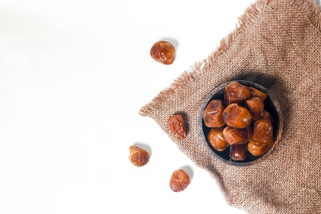 Ramadan special red dates fruit on a white background