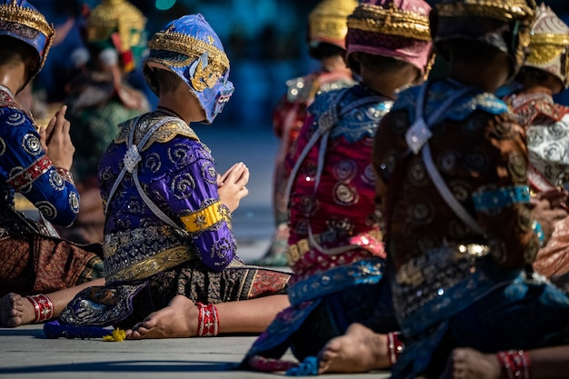 Ramayana pantomime story dancing and acting on the ground by thai students in thai temple