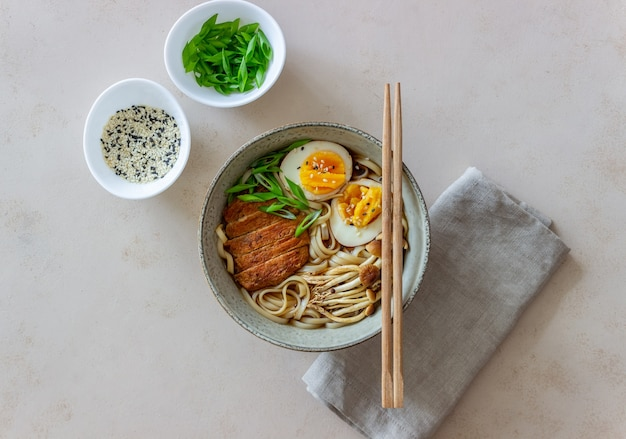 Ramen soup with noodles, pork, mushrooms and eggs. japanese cuisine. recipe.